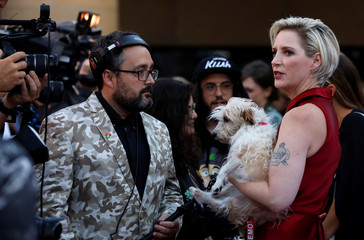 """Director Feste holds her dog Loretta as she is interviewed at the premiere for the movie """"Boundaries"""" in Los Angeles"""