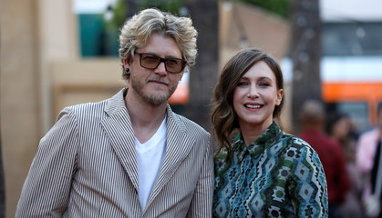 "Cast member Farmiga and her husband Hawkey pose at the premiere for the movie ""Boundaries"" in Los Angeles"