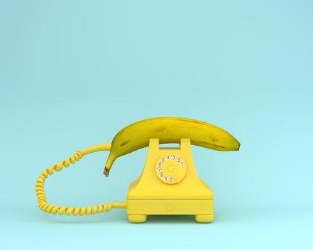 Creative idea layout fresh banana with yellow retro telephone on bluish background.  Fruit minimal concept.