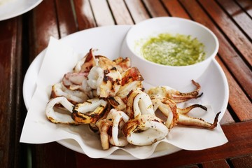 close up hot squid grilled on table