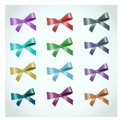 Collection of vector multicolored bows on a light background