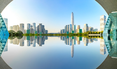 Beautiful modern city skyline and water reflection in Shenzhen