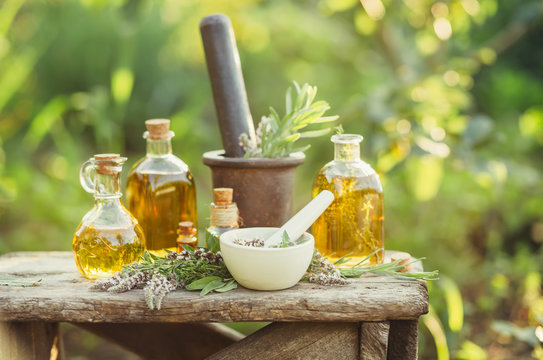 Various massage and cosmetic oils in glass bottles