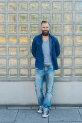 Casual friendly bearded man in blue denim