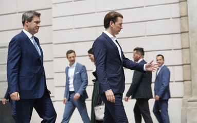 Austria's Chancellor Kurz and Bavaria's Prime Minister Soeder prepare for a family photo after a joint cabinet meeting in Linz