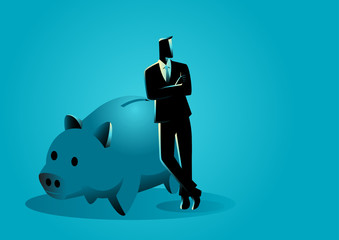 Banker leaning on giant piggy bank