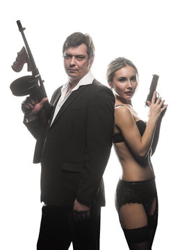 A couple of gangsters, a man and woman with guns