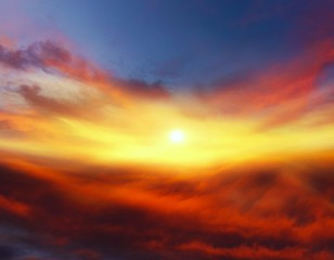 Sunset . Sunlight pierces through the clouds . Background sky at sunset and dawn .  Flare