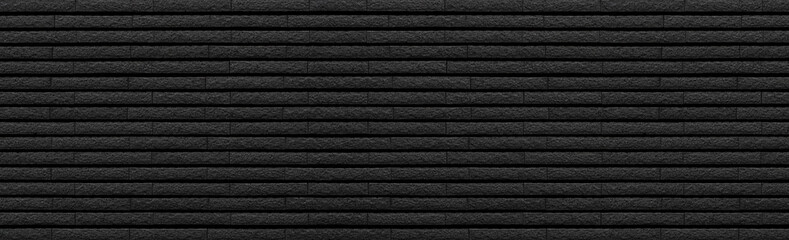 Panorama of Black stone brick tile wall pattern and background