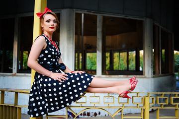 beautiful young woman posing in retro dress