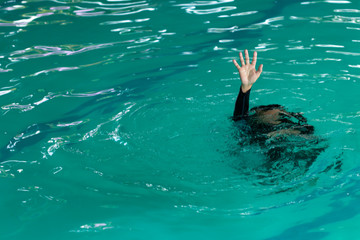 Drowning victims, Hand of drowning woman needing help, selective focus. Failure and rescue concept. Fototapete