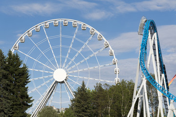 Ferris wheel and roller coaster in the amusement Park.