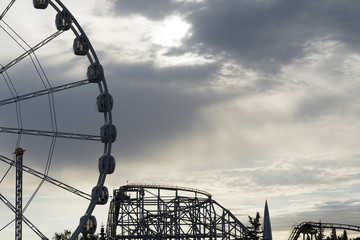 Big Ferris Wheel on clear blue sky background, close up