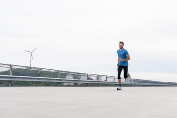 Man running on a parking level