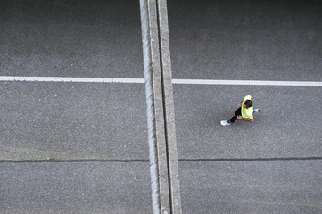 Top view of man running on a street