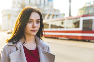 Russia, St. Petersburg, portrait of young woman in the city