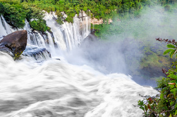 Kalandula waterfalls of Angola in full flow with lush green rain forest, rocks and spray, Africa