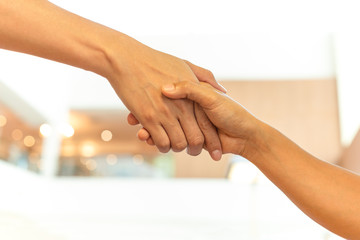 Successful conceptual people hand shaking hands