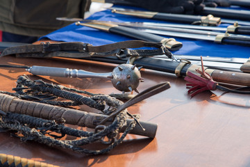 Medieval weapons made by themselves on the table in the market