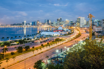 Skyline of capital city Luanda, Luanda bay and seaside promenade with highway during afternoon, Angola, Africa Wall mural