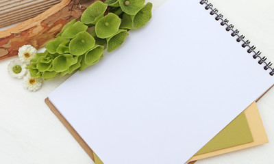 Notepad mockup with green flowers, sketchbook