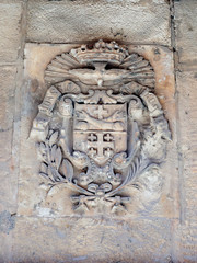 Silent streets in the old city of Jerusalem, Israel. The coat of arms on the wall of the house on Via Delorosa