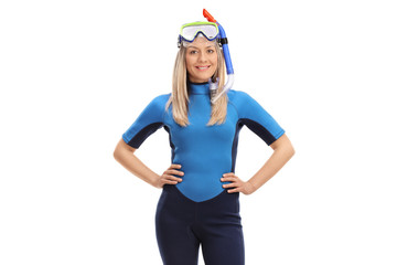 Young woman with a swimsuit and snorkeling equipment