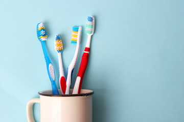 toothbrushes in a glass on a colored background. oral health, brush your teeth, healthy teeth