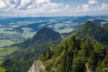 View from the top of the mountain to the Sromowce village by the river. Bialy Dunajec in Pieniny, view from the top of the Three Crowns. The highest peak of the Pieniny, Trzy Korony.