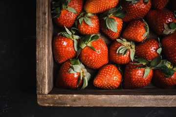 Ripe strawberries on the rustic background. Selective focus.