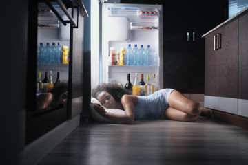 Black Woman Awake For Heat Wave Sleeping in Fridge