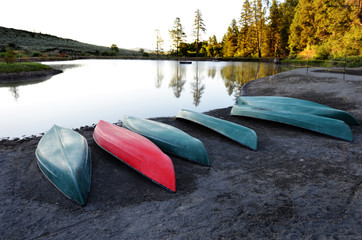 Canoes Boats Near Lake in Mountains Wilderness