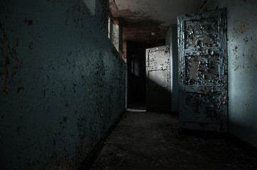 abandoned old german psychiatry hospital empty hallway broken windows and walls - scary haunted asylum old house