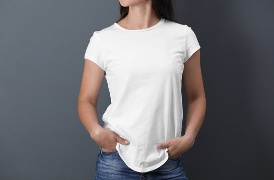 Young woman in white t-shirt on color background. Mockup for design