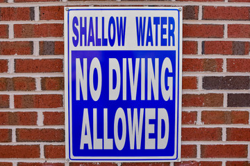 shallow water no diving allowed sign