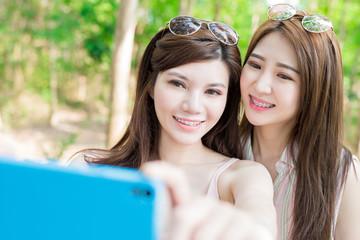 two beauty women selfie happily