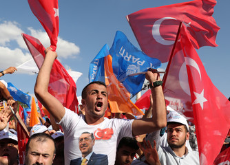 Supporters of Turkish President Tayyip Erdogan shout and wave flags during a rally in Mardin
