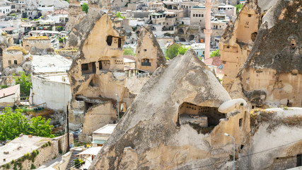 ancient rock-cut houses in Goreme town in spring