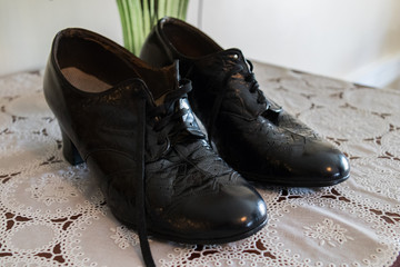 Pair of old fashioned shiny black leather lace up women's shoes