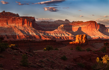 Glorious sunset on the rock formations of Capitol Reef National Park in Utah , USA. Wall mural