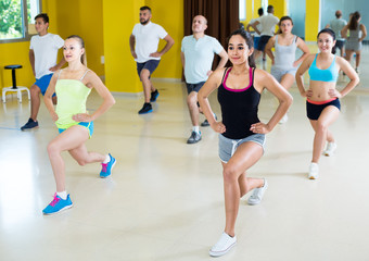 Young  people exercising in dance hall