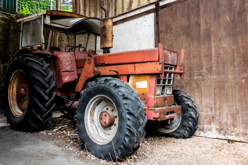 Old Farm tractor waiting for a lovely person to take care of it.