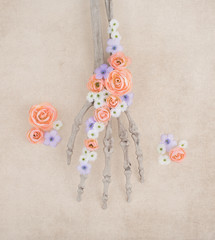Painted Skeleton Hand with Spring Flowers