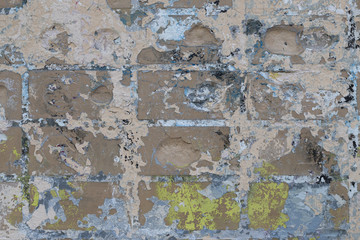 Fotobehang Oude vuile getextureerde muur Background of old color vintage stonewall with peeling plaster texture. Abstract design element