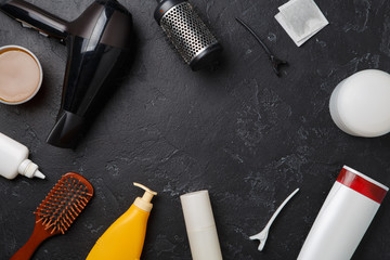 Photo of hairdresser accessories, hair dryer, combs, in circle on empty black background,