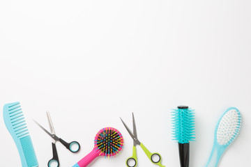 Photo of combs and scissors isolated on white background.