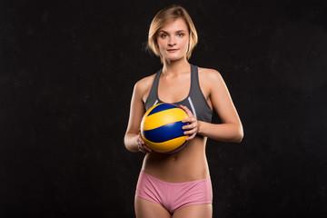 Girl beach volleyball player on a dark background