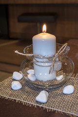 Wedding candle with white pebbles around it.