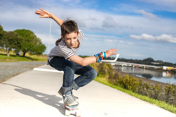 outdoor portrait of young preteen boy skating on urban background