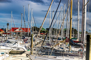 yachts in a harbour, sea port town, pier with lots of sail ships